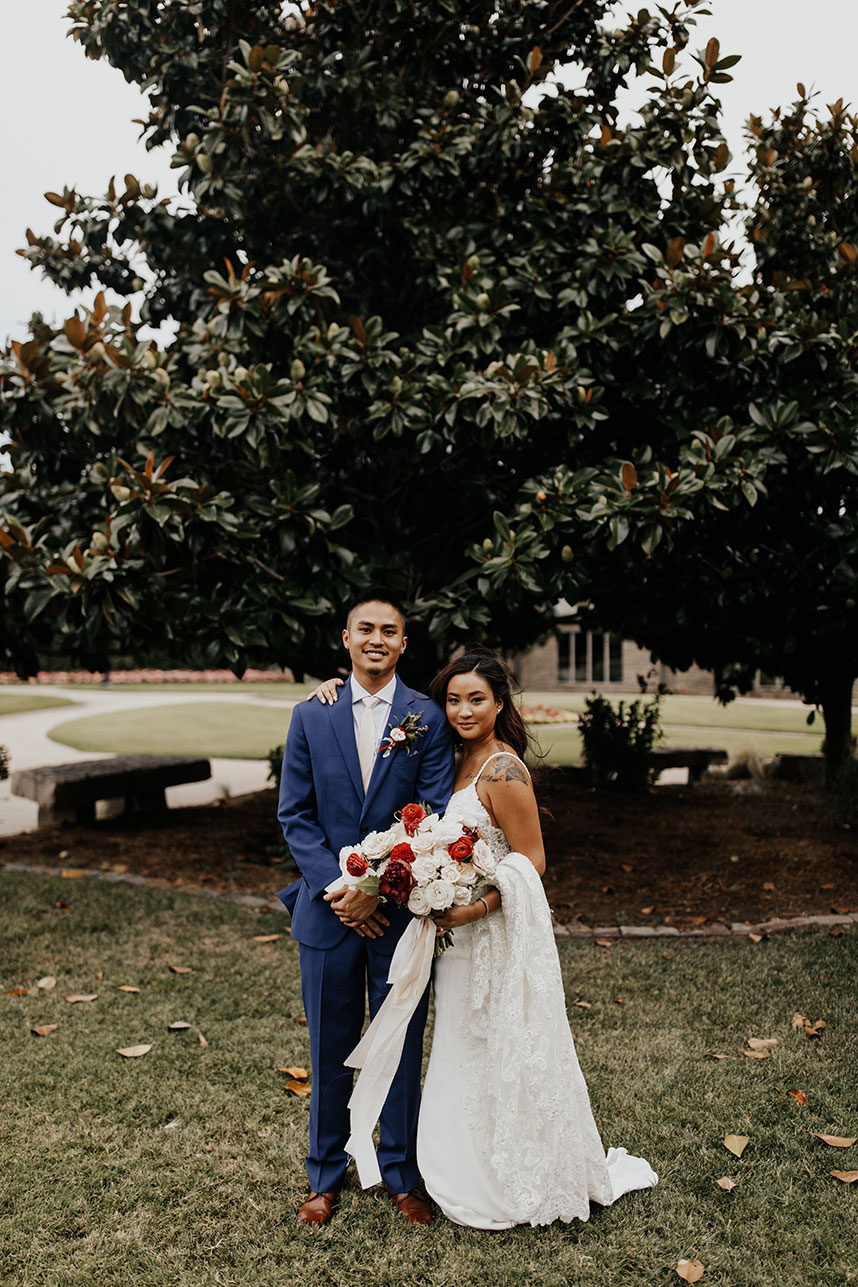 choosing a wedding photographer - couple standing by a tree