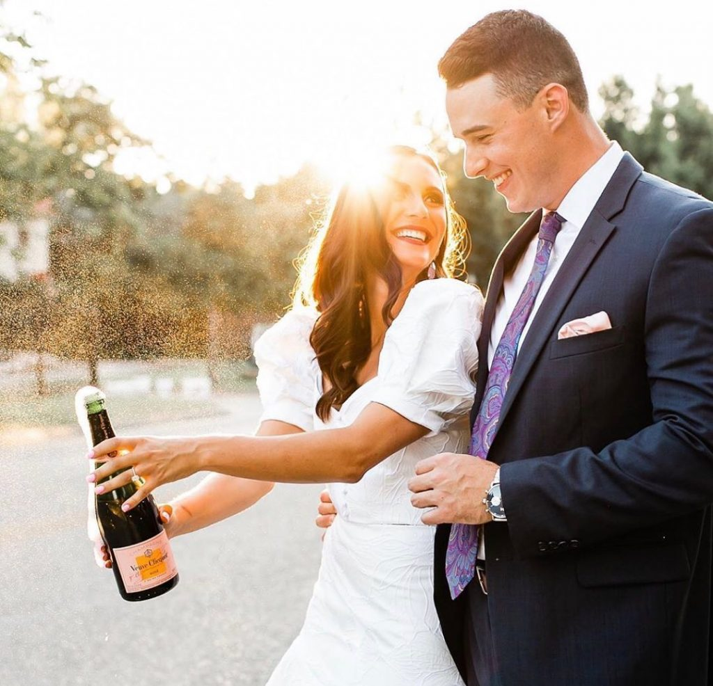 File this under...pictures we have to look at twice! Golden hour + bottle of bubbly + a new shiny ring