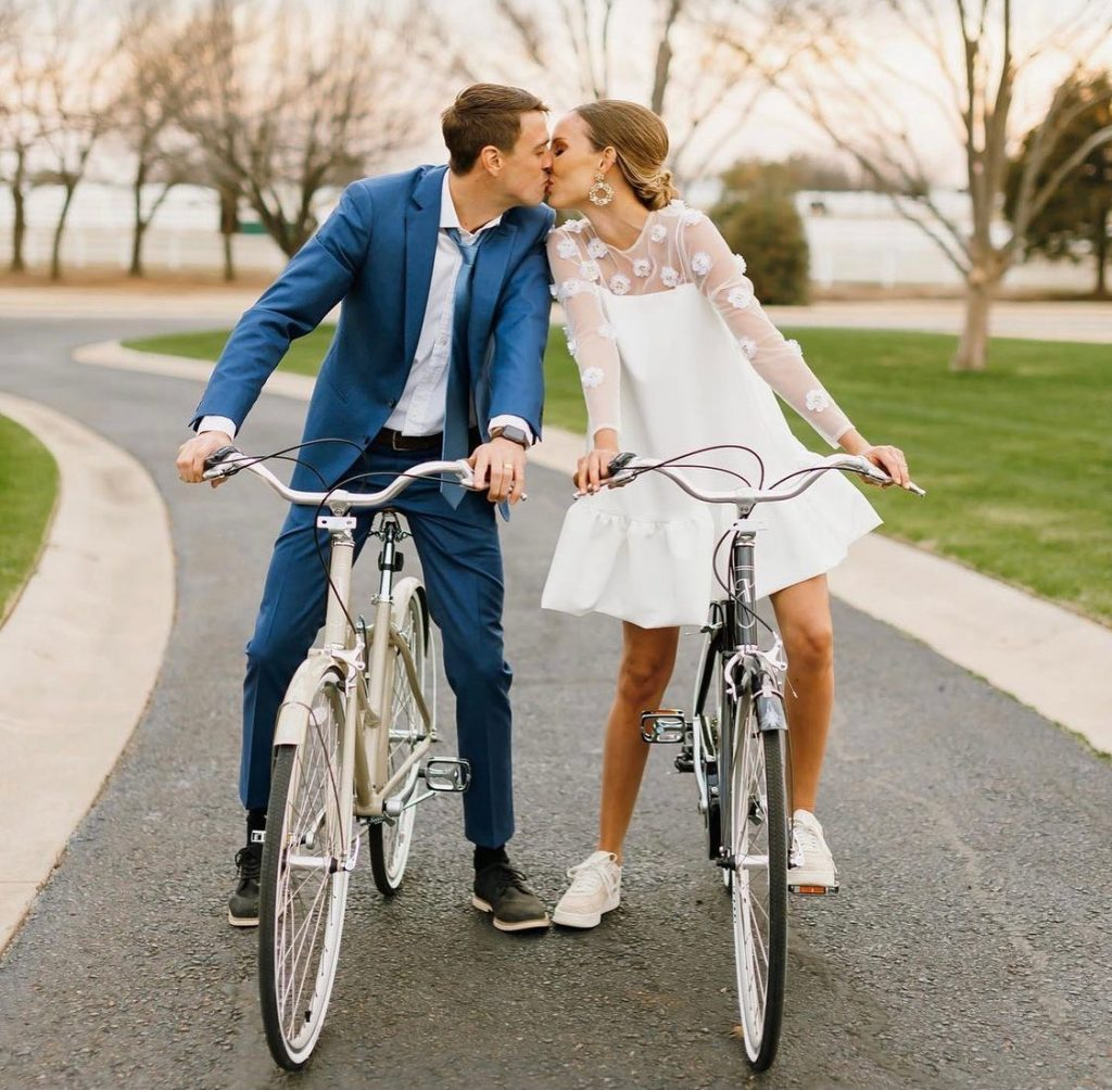 Custom-made dresses from avaribridal are perfect to accommodate an array of wedding day festivities...including riding your bike around the gorgeous