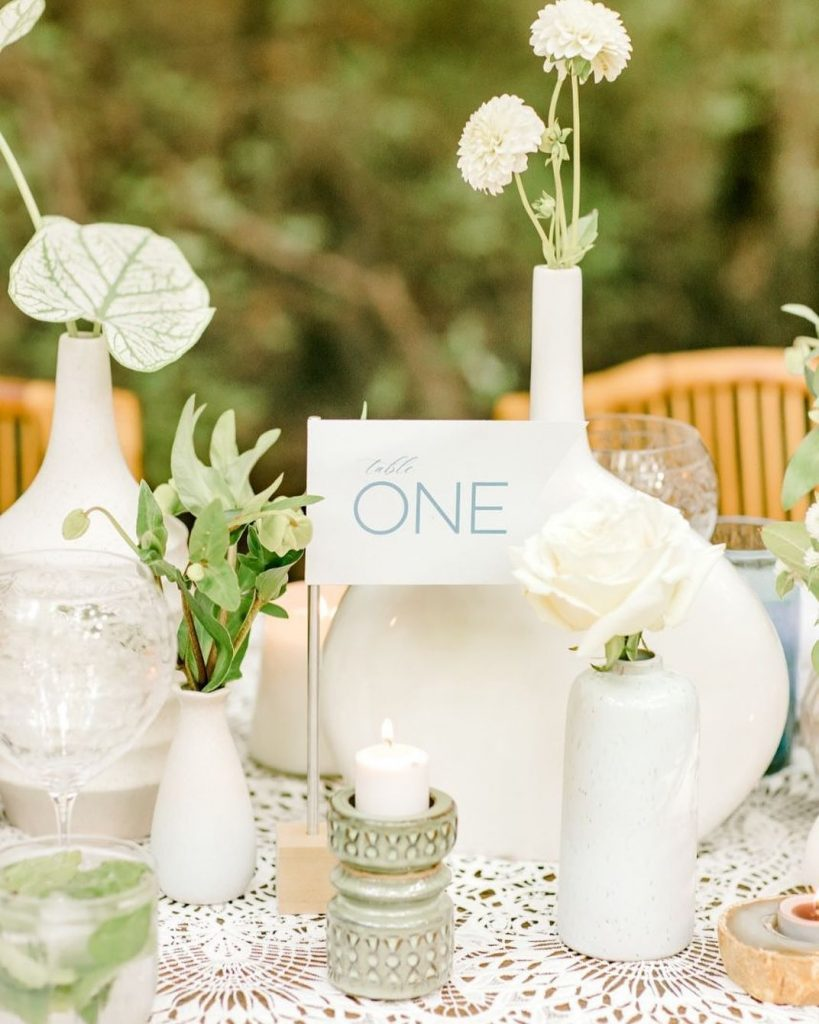 Elevate your tablescape with an array of organic elements and a darling table marker. This earthy aesthetic is making all
