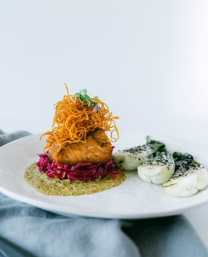 Cherry wood-smoked & grilled salmon with beet kraut, maple and fennel mustard and candied root vegetable curls with sautéed garlic